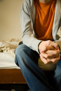 Man praying on bed
